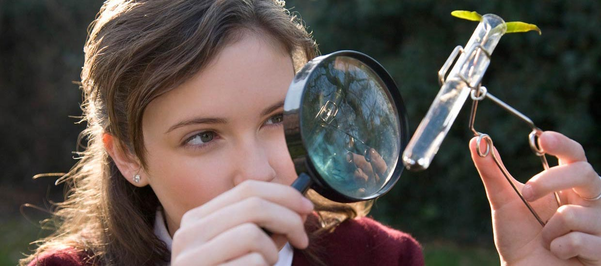 pupil looking through magnifying glass